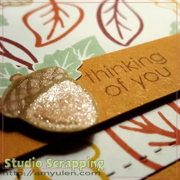 Close up photo of a stamped acorn covered in glitter
