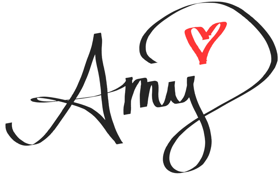 """Handwritten text that says """"Amy"""" with a heart after the letter y."""